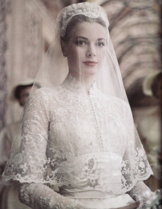 Princess-Grace-Kelley-Wedding-Dress-made-of-chiffon-and-lace-with-tightly-accentuated-waist-with-overlays-embellishments-and-embroideryw-weddinggowns.com_-698x900